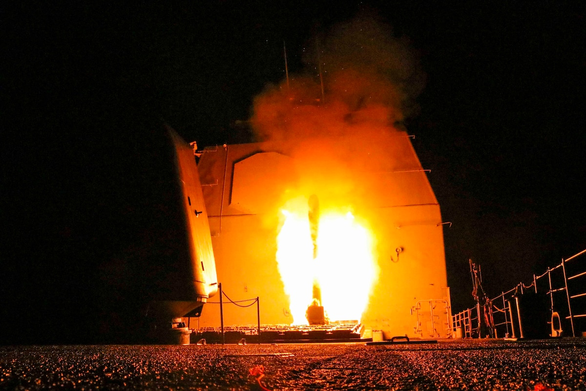 A guided missile cruiser fires a Tomahawk missile.