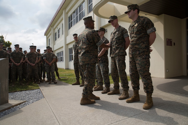 3rd Marine Division Commanding General Maj. Gen. Craig Q. Timberlake presents an appreciation coin to U.S. Marines and Sailors attached to 3rd Marine Division April 13, 2018, on Camp Schwab in Okinawa, Japan. The service members competed in the 2018 Marine Corps Forces Special Operations Command Raider Games March 18-27. The four man team finished 2nd place out of nine other teams that competed.