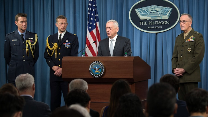 Defense Secretary James N. Mattis and Marine Corps Gen. Joe Dunford, chairman of the Joint Chiefs of Staff, brief reporters at the Pentagon about military operations in Syria, April 13, 2018.