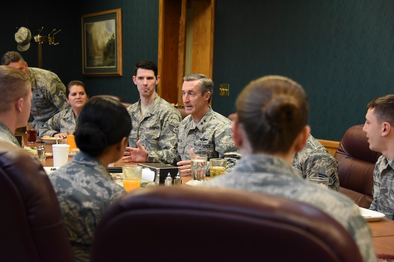 Maj. Gen. Ronald Miller (center), 10th Air Force commander, talks with Air Force reservists April 14 during his visit to the 419th Fighter Wing.