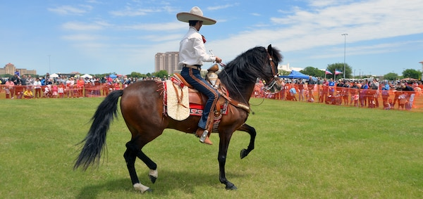 Impressive feats of horsemanship were on display during exhibition of Spanish horses during the annual Cowboys and Heroes event held at MacArthur Parade Field at Joint Base San Antonio-Fort Sam Houston April 14.