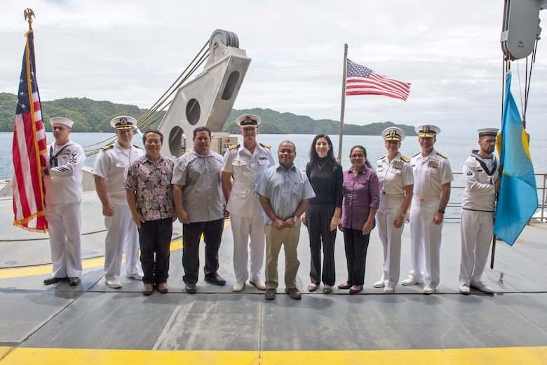 KOROR, Palau (April 14, 2018) The official party for the Pacific Partnership 2018 (PP18) Palau mission stop closing ceremony aboard Military Sealift Command expeditionary fast transport ship USNS Brunswick (T-EPF 6), stand together for a group photo at the ceremony's conclusion, April 14. PP18's mission is to work collectively with host and partner nations to enhance regional interoperability and disaster response capabilities, increase stability and security in the region, and foster new and enduring friendships across the Indo-Pacific Region. Pacific Partnership, now in its 13th iteration, is the largest annual multinational humanitarian assistance and disaster relief preparedness mission conducted in the Indo-Pacific.