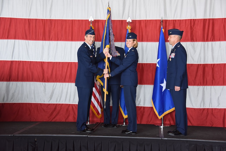 "Col. Regina ""Torch"" Sabric, 419th Fighter Wing commander, accepts the wing flag from Maj. Gen. Ronald Miller, 10th Air Force commander, during a change of command ceremony April 14, 2018, at Hill Air Force Base, Utah."