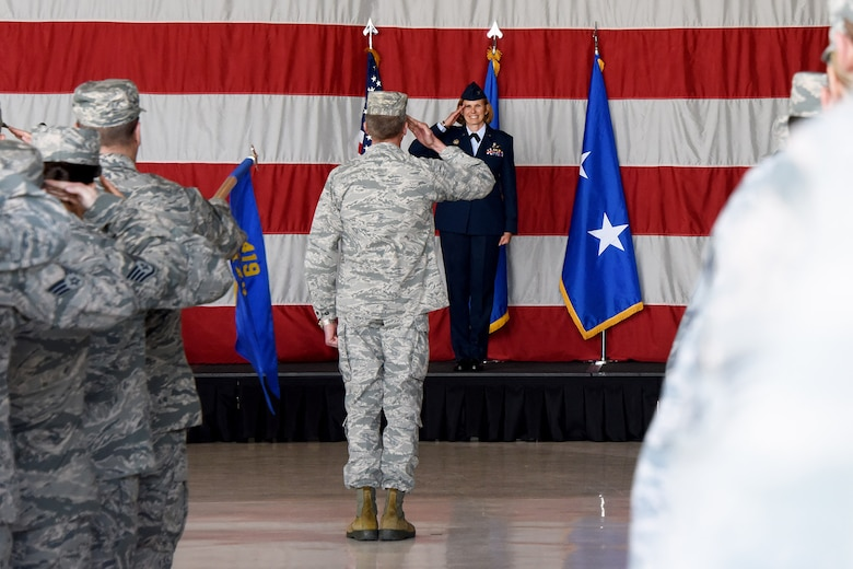 "Col. Regina ""Torch"" Sabric renders her first salute as new commander of the 419th Fighter Wing during a ceremony April 14, 2018, at Hill Air Force Base, Utah."
