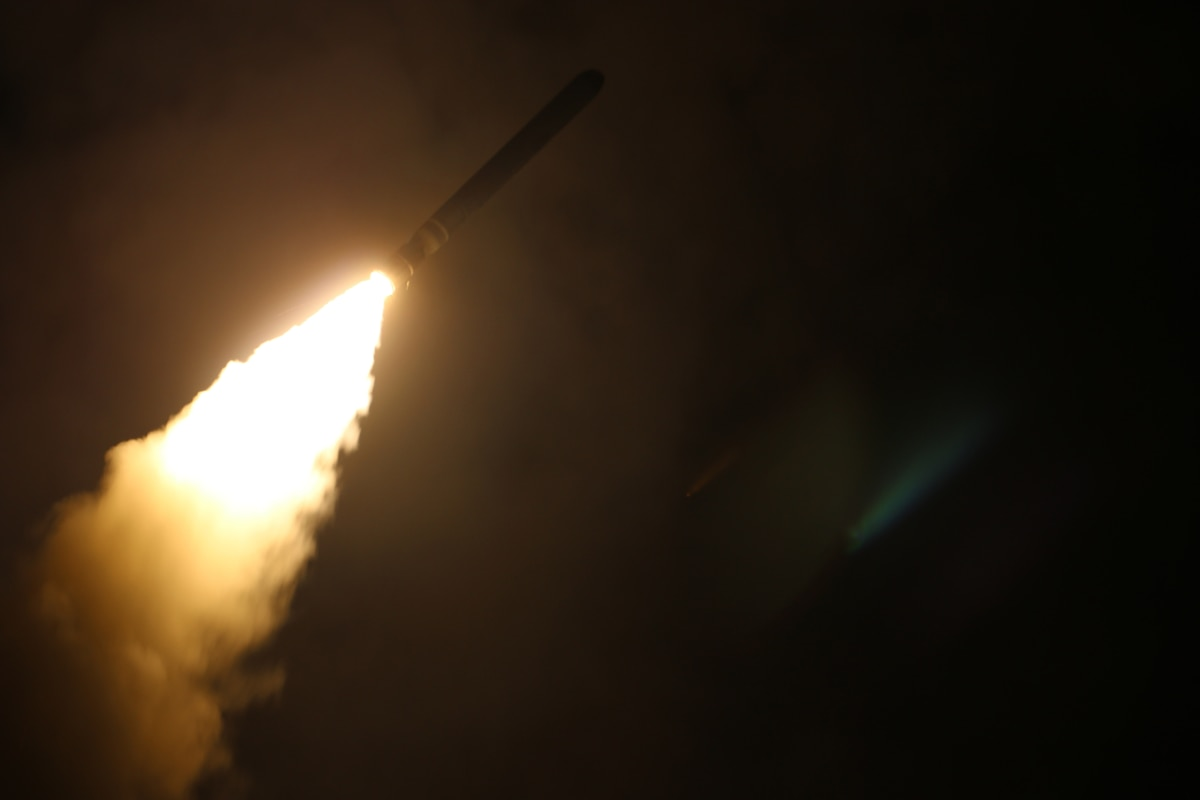 A missile launches at night.