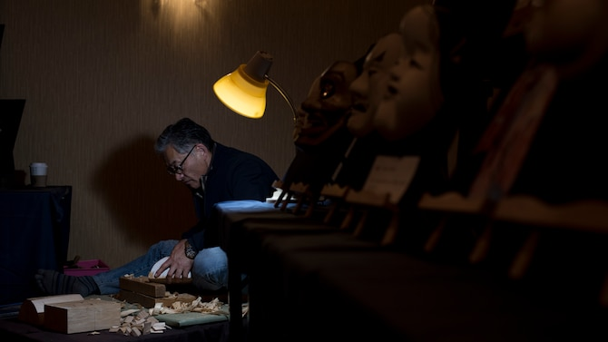 Suwanat Kazuo, a mask artist, carves a mask during the 31st Annual Japan Day at Misawa Air Base, Japan, April 14, 2018. Hirotoshi Mikami started the 31-year-old tradition which included 50 host nation organizations and more than 500 performers, artists and craftsmen. The base-wide celebration gave Team Misawa a chance to experience authentic Japanese culture. (U.S. Air Force photo by Airman 1st Class Collette Brooks).