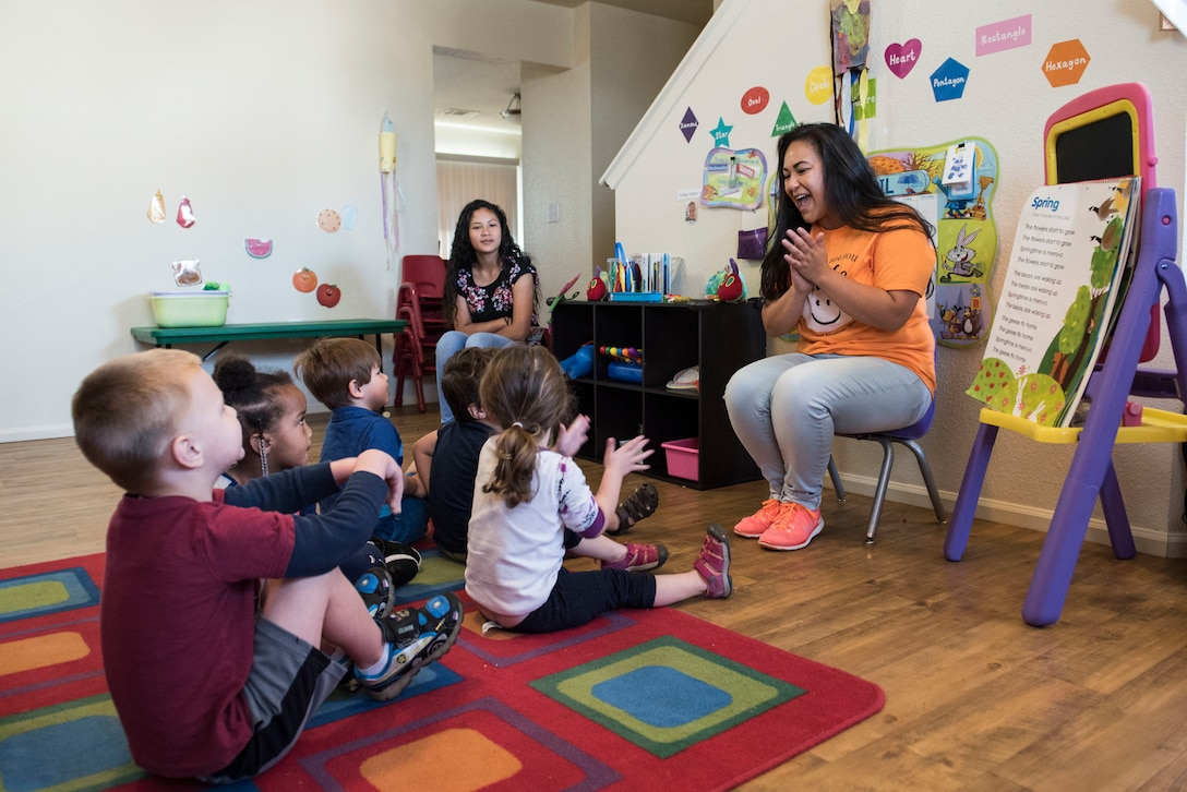 Talia Sustaita, Family Child Care (FCC) Program provider, sings songs with her children at Shaw Air Force Base, S.C., April 12, 2018.