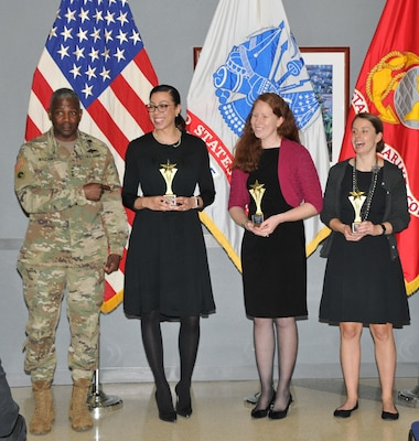 DLA Director Lt. Gen. Darrell Williams congratulates the winning team (L-R): Alison Adams, Patty Beyer and Laura Funk. Not pictured: Debra Simpson and DaToya Taylor. Photo by Teodora Mocanu.