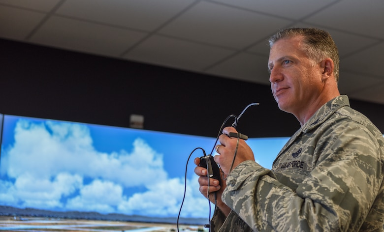 Col. David Eaglin, 39th ABW commander operates flight simulator