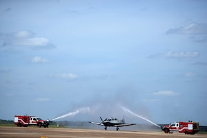 Lt. Col. Brent Green, 43rd FTS assistant director of operations, is hosed down after his fini flight April 13, 2018, on Columbus Air Force Base, Mississippi. Green, is retiring April, 13 after 28 years of service and will continue to support the Air Force and Columbus AFB in the capacities he can. (U.S. Air Force photo by Airman 1st Class Keith Holcomb)
