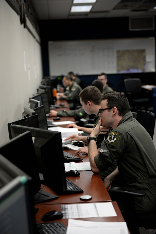 Student pilots in the 48th Flying Training Squadrons study for and plan their next flight April 10, 2018, on Columbus Air Force Base, Mississippi. Students throughout pilot training study often to keep up with the demanding syllabus. (U.S. Air Force photo by Airman 1st Class Keith Holcomb)