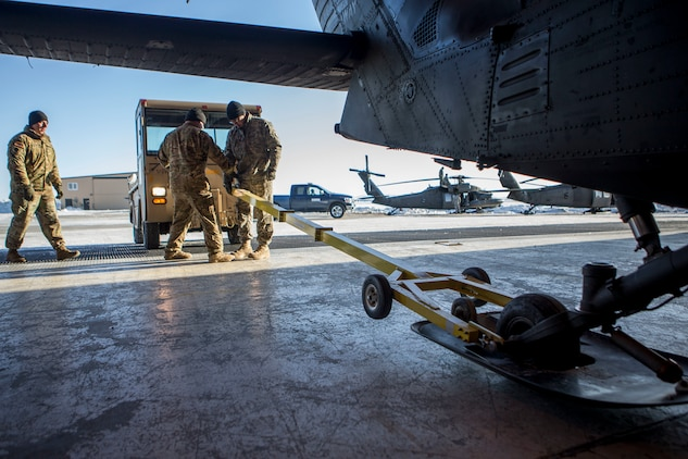 U.S. Army personnel prepare a U.S. Army UH-60 Black Hawk helicopter prior to departure from the flight line, Kotzebue, Alaska, and travel to outlying villages, in support of Innovative Readiness Training Arctic Care, April 14, 2018. Service members in support of IRT Arctic Care will conduct critical mission training and logistical movements in order to simulate military/civilian humanitarian operations and health care delivery in time of crisis, conflict or disaster. (U.S. Marine Corps photo by Lance Cpl. Ricardo Davila)