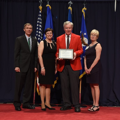 DAYTON, Ohio -- Richard Isaacks (red jacket) received the 2017 Director's Award for Volunteer of the Year for his dedication and excellence in serving the National Museum of the U.S. Air Force. (from left to right) Museum Director Lt. Gen.(Ret.) Jack Hudson, Air Force Materiel Command Executive Director Patricia M. Young, Volunteer Richard Isaacks, and Air Force Museum Foundation Board of Trustees President Col.(Ret.) Susan E. Richardson . (U.S. Air Force photo)