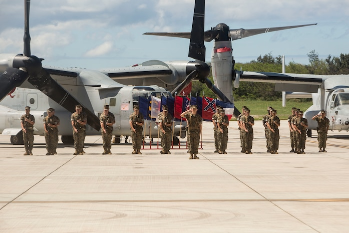 U.S. Marines with Marine Medium Tiltrotor Squadron 268 (VMM-268) present arms during a change of command ceremony, Marine Corps Air Station Kaneohe Bay, Marine Corps Base Hawaii, April 5, 2018. Lt. Col. Patrick Robinson retired and relinquished command of the squadron to Lt. Col. Richard Alvarez. (U.S. Marine Corps photo by Lance Cpl. Isabelo Tabanguil)