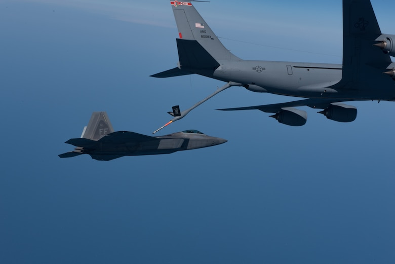 A KC-135 Stratotanker from the 121st Air Refueling Wing refuels an F-22 Raptor from the 1st Fighter Wing over the Atlantic Ocean, April 12, 2018. The 1st Fighter Wing is home to the 94th Fighter Squadron and 27th Fighter Squadron at Joint Base Langley-Eustis, Va. and the 121st ARW is from Rickenbacker Air National Guard Base, Ohio. (U.S. Air Force photo by Staff Sgt. Carlin Leslie)