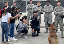 South San Antonio High School students take pictures of Balto, an 802nd Security Forces Squadron military working dog, during a Troops for Teens event at Joint Base San Antonio-Lackland, Texas, March 9, 2018. Troops for Teens, a joint SSAHS and Air Forces Cyber volunteer program, links Airmen mentors with teens. (U.S. Air Force photo by Tech. Sgt. Jamie Adimora)