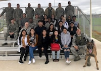 South San Antonio High School students and Joint Base San Antonio-Lackland Airmen pose for a photo during a Troops for Teens event at JBSA-Lackland, Texas, March 9, 2018. Troops for Teens, a joint SSAHS and Air Forces Cyber volunteer program, links Airmen mentors with teens. (U.S. Air Force photo by Tech. Sgt. Jamie Adimora)