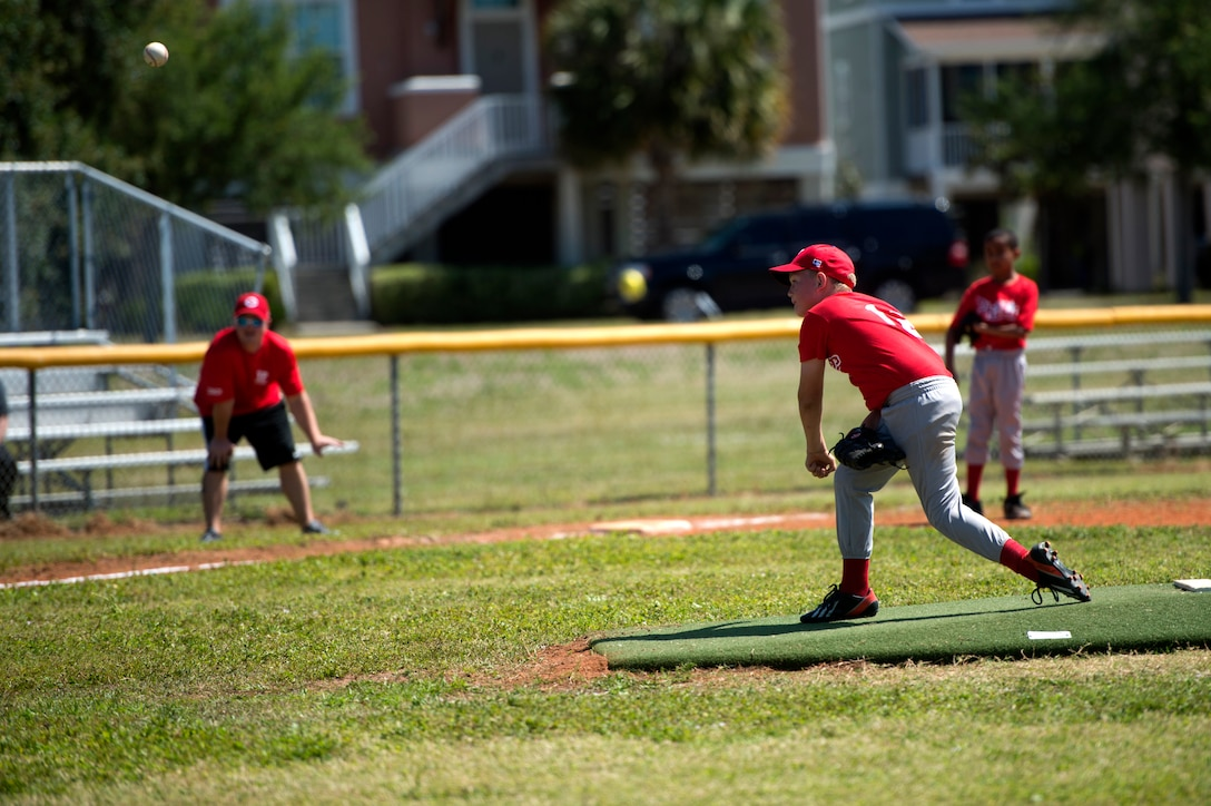 Children play baseball during opening day of youth baseball at MacDill Air Force Base, Fla., April 14, 2018.