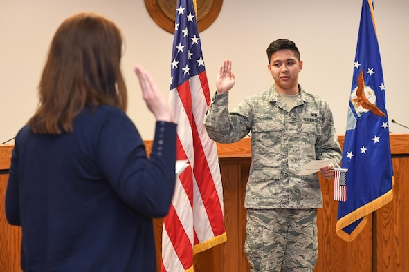 Airman 1st Class Kyle Lapid, 75th Air Base Wing Judge Advocate Office, swears his oath of allegiance to become a U.S. citizen April 10, 2018, at Hill Air Force Base, Utah. (U.S. Air Force photo by Cynthia Griggs)