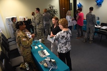 Team Shaw members converse during a Sexual Assault Prevention and Response (SAPR) office open house at Shaw Air Force Base, S.C., April 12, 2018.