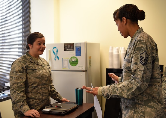 U.S. Air Force Capt. Lauren Kerby, 628th Air Base Wing Special Victims' Counsel, left, speaks with Master Sgt. Tanya Wyatt, 20th Fighter Wing Equal Opportunity superintendent, during a Sexual Assault Prevention and Response office open house at Shaw Air Force Base, S.C., April 12, 2018.