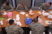 U.S. Airmen complete a pre-test during a Dad's 101 class at Shaw Air Force Base, S.C., April 13, 2018.