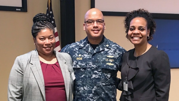 Navy Capt. David Rhone, DCMA Lockheed Martin Moorestown's commander, thanked Melissa Burgess and Crystal Craddock from DCMA headquarters' Human Capital directorate, for presenting information to the workforce during the training day held on April 4 in New Jersey. (DCMA photo by Kareem Soto)