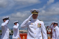 Cmdr. Christopher Hedrick, commanding officer of the Los Angeles-class fast-attack submarine USS Santa Fe (SSN 763) is piped ashore following a change of command ceremony on the submarine piers in Joint Base Pearl Harbor-Hickam, April 13.