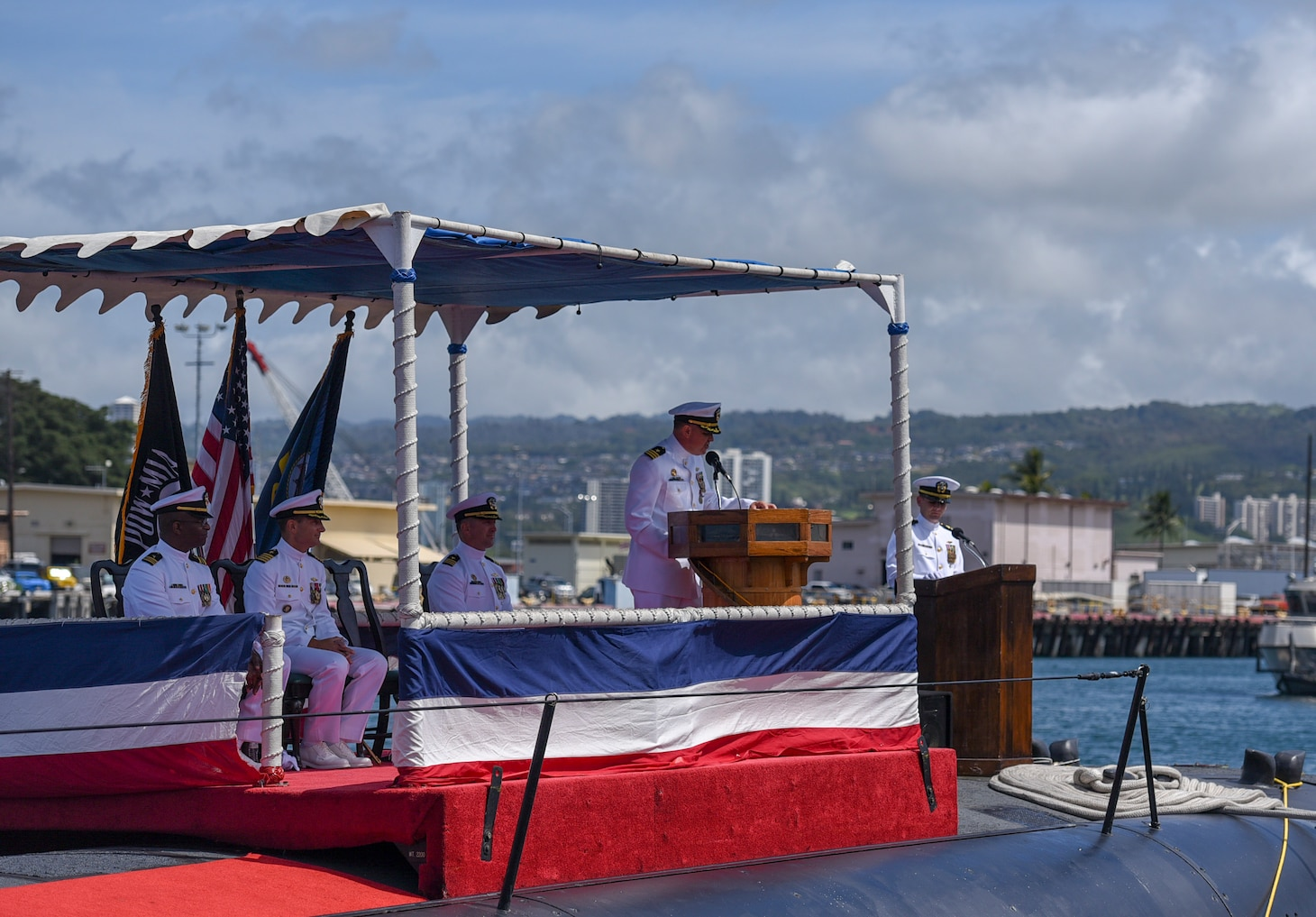 Cmdr. Jacob A. Foret, commanding officer of the Los Angeles-class fast-attack submarine USS Santa Fe (SSN 763), addresses guests during a change of command ceremony on the submarine piers in Joint Base Pearl Harbor-Hickam, April 13.