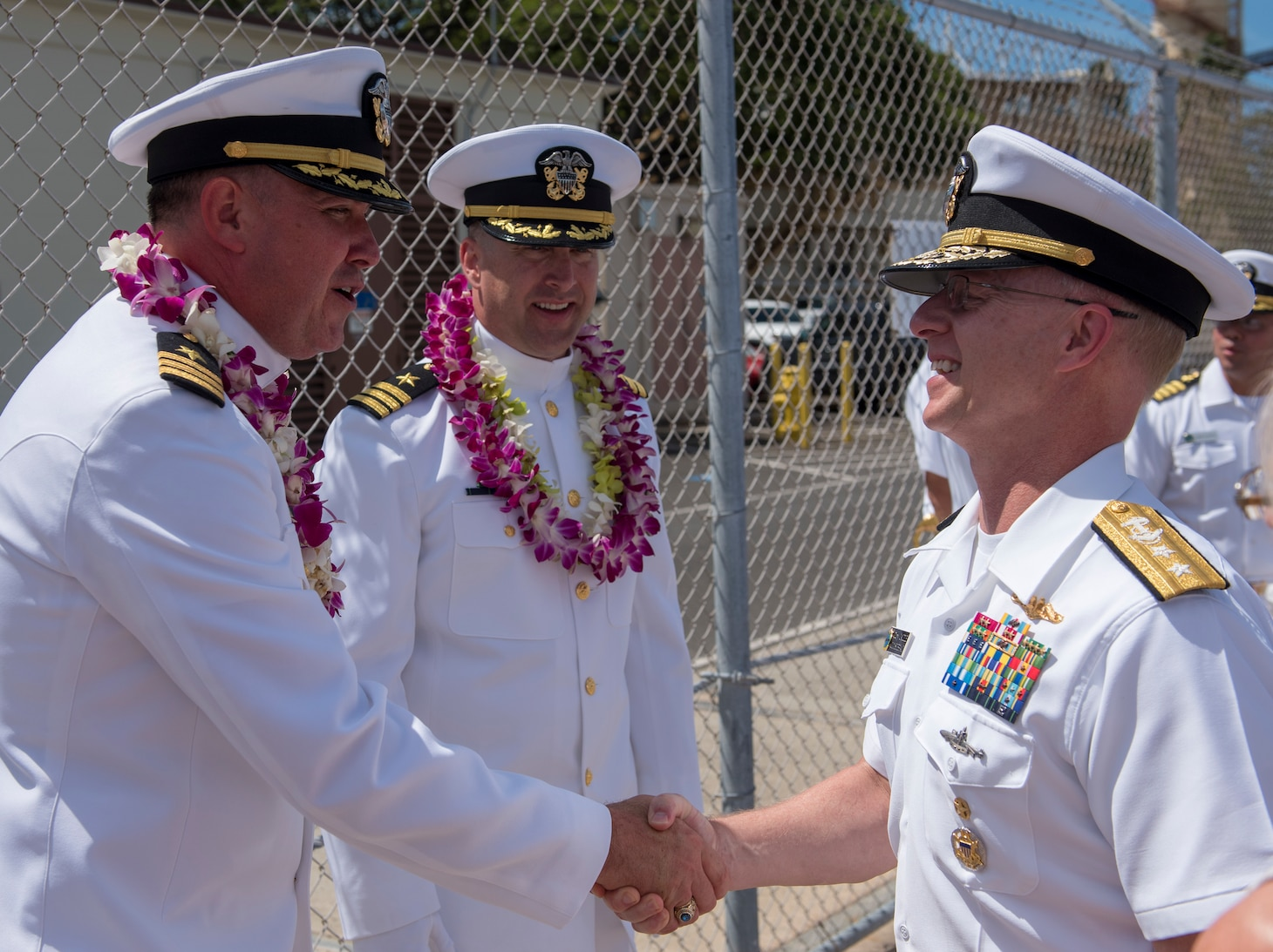 Rear Adm. Daryl L. Caudle, commander, Submarine Force, U.S. Pacific Fleet, right, congratulates Cmdr. Jacob A. Foret following the Los Angeles-class fast-attack submarine USS Santa Fe (SSN 763) change of command ceremony on the submarine piers in Joint Base Pearl Harbor-Hickam, April 13.