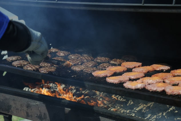 CAMP FOSTER, OKINAWA, Japan – Burgers are being grilled during the Kubasaki High School Month of the Military Child barbecue April 10 aboard Camp Foster, Okinawa, Japan.