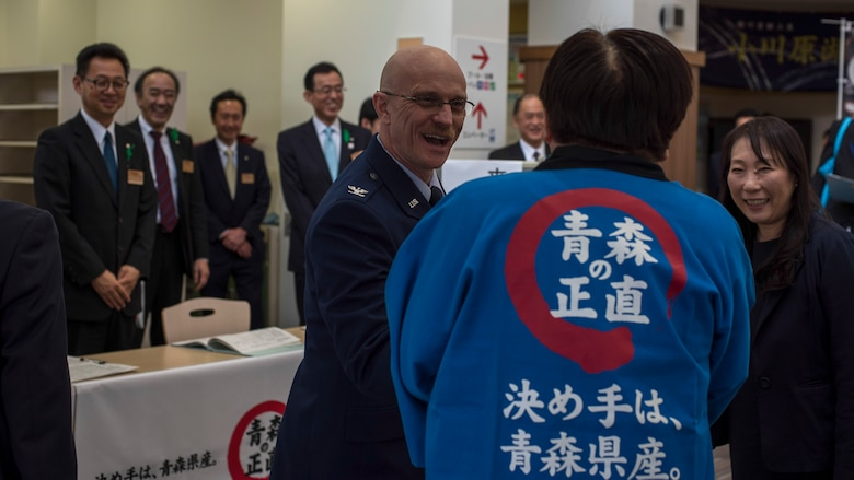 U.S. Air Force Col. R. Scott Jobe, left, the 35th Fighter Wing commander, shakes hands with Governor Shingo Mimura, right, the Aomori Prefecture governor, at the at Lake Ogawara Appreciation event in Tohoku Town, Japan, April 15, 2018. The partnership of local communities is vital to the U.S. and Japan friendship. (U.S. Air Force photo by Airman 1st Class Collette Brooks)