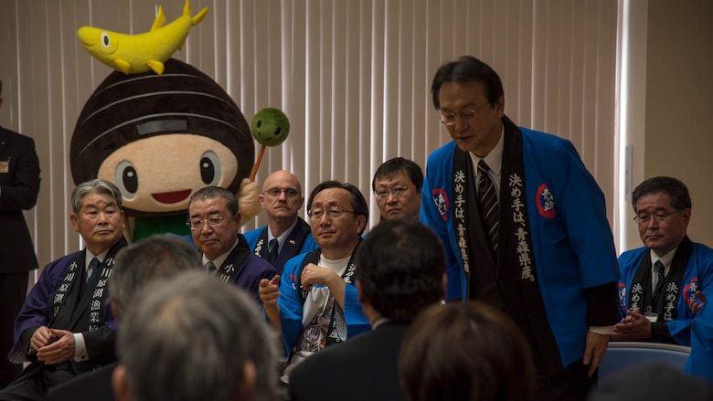 Akinori Eto, a member of the House of Representatives , bows at the Lake Ogawara Appreciation event in Tohoku Town, Japan, April 15, 2018. The event focused on community relations and fundamentals for the U.S. and Japan alliance. (U.S. Air Force photo by Airman 1st Class Collette Brooks)