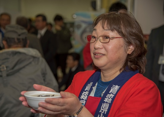 Ebina Ikuko, a Lake Ogawara volunteer, serves soup to attendees at the Lake Ogawara Appreciation event in Tohoku Town, Japan, April 15, 2018. The community engagement event signifies the close relationship between Team Misawa members and the people of Tohoku Town. . (U.S. Air Force photo by Airman 1st Class Collette Brooks)