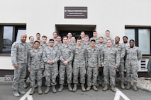 The 86th Vehicle Readiness Squadron vehicle operations flight poses for a group photo on Ramstein Air Base, Germany, April 11, 2018. Between 2016 and 2017, the 86th VRS Vehicle Operations Flight decreased accidents by 40 percent, and saved approximately $21,800 in total savings and cost avoidance the last year. Innovation Madness is a competition-based outreach campaign promoting continuous process improvement and cultivating a culture of innovation throughout U.S. Air Forces in Europe. (U.S. Air Force photo by Senior Airman Savannah L. Waters)