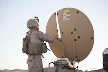 U.S. Marine Corps Cpl. Anthony Salas, a network administrator with the 15th Marine Expeditionary Unit, installs a Hawkeye III Satellite in Iraq, Dec., 4, 2017. The communications team was deployed in support of the 15th MEU's aviation combat element conducting missions in support of Combined Joint Task Force Operation Inherent Resolve.