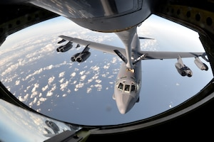 A B-52 Stratofortress gets refueled in flight.