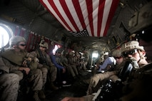 U.S. Marines with Task Force Southwest (TFSW) ride aboard a CH-47 Chinook after a security shura at the police headquarters in Lashkar Gah, Afghanistan, March 27, 2018. The meeting allowed Marine advisors with TFSW to build rapport with their counterparts to further the train, advise, assist mission in preparation for Operation Nasrat I in Helmand Province. (U.S. Marine Corps photo by Sgt. Sean J. Berry)