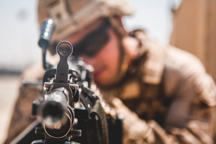A U.S. Marine with Task Force Southwest (TFSW) provides security during a key-leadership engagement at Camp Nolay, Afghanistan, April 7, 2018. TFSW advises at the brigade level to enable the Afghan National Defense and Security Forces during near continuous combat operations to increase the stability for the local populace.  (U.S. Marine Corps photo by Sgt. Conner Robbins/ Released)