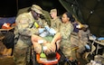 Army Reserve Staff Sgt. Robert Johnson (left), the noncommissioned officer-in-charge of non-ambulatory decontamination operations and native of Columbia, South Carolina, assigned to the 414th Chemical Company, 415th Chemical Brigade, 76th Operational Response Command, assist his team of Soldiers in processing an