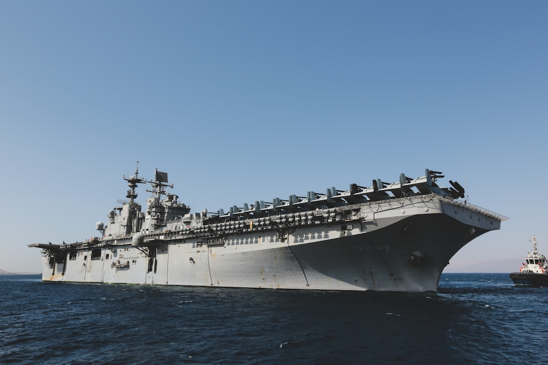 AQABA, Jordan (April 15, 2018) – USS Iwo Jima (LHD 7) and embarked 26th Marine Expeditionary Unit arrive in Aqaba, Jordan for exercise Eager Lion 18. Eager Lion is a major training event that provides U.S. forces and Jordan Armed Forces the opportunity to improve their collective ability to plan and operate in a coalition-type environment. (U.S. Marine Corps photo by Staff Sgt. Vitaliy Rusavskiy/Released)