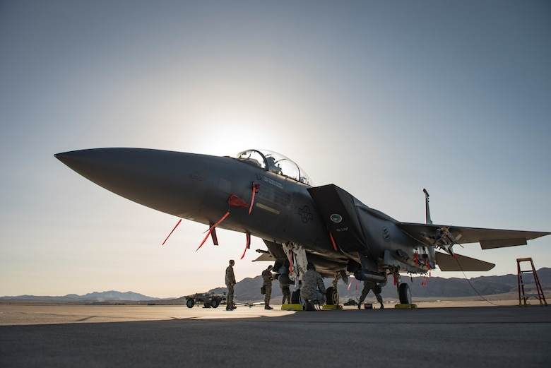 Airmen assigned to the 389th Aircraft Maintenance Unit, Mountain Home Air Force Base, Idaho, perform final checks on an F-15 Eagle fighter jet during a load crew competition at Nellis Air Force Base, Nevada, April 13, 2018. Each team consisted of three members who played a specific role in the competition to increase their team's success by working as one cohesive unit.(U.S. Air Force photo by Airman 1st Class Andrew D. Sarver)