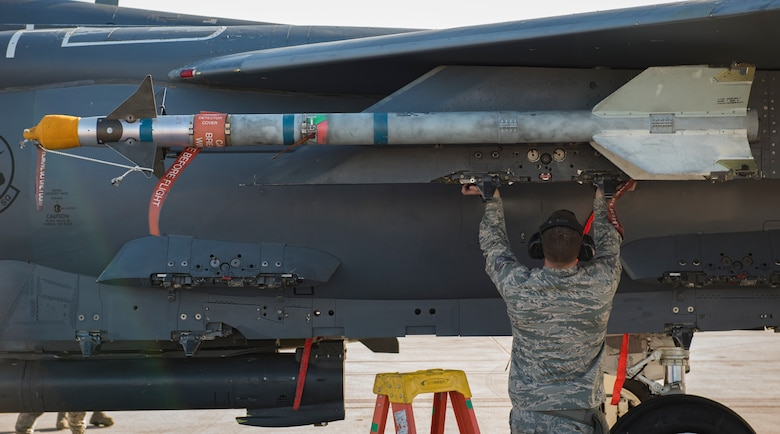 Staff Sgt. Dustin Machen, 389th Aircraft Maintenance Unit weapons loader from Moutain Home Air Force Base, Idaho, performing final checks on an F-15 Eagle fighter jet during a load crew competition at Nellis Air Force Base, Nevada, April 13, 2018. Load crew competitions provide weapons loaders the opportunity to display their weapons loading skills to their peers and superiors.(U.S. Air Force photo by Airman 1st Class Andrew D. Sarver)