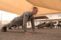 Members of Honor Guard units from Luke Air Force Base, Ariz., and other local areas, perform pushups under the direction of instructors from the official U.S. Air Force Honor Guard April 16, 2018. The Air Force Honor Guard visited Luke as part of an effort to enrich the skill sets of localized Honor Guard units at individual bases. (U.S. Air Force photo by Senior Airman Ridge Shan)