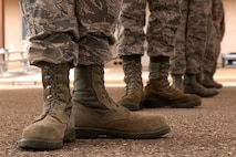 Local Honor Guard Airmen practice foot placement during formation training under the direction of instructors from the U.S. Air Force's official Honor Guard team April 16, 2018, at Luke Air Force Base, Ariz. Honor Guard members perform special formations and demonstrate military tradition and discipline at a variety of military and civilian ceremonies and events. (U.S. Air Force photos by Senior Airman Ridge Shan)