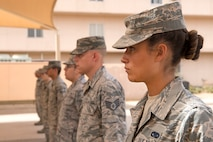 Local Honor Guard Airmen stand at attention as they learn from instructors from the U.S. Air Force's official Honor Guard team April 16, 2018, at Luke Air Force Base, Ariz. Members of the Air Force Honor Guard team came to Luke to train local Honor Guard members on special techniques, formations, and demonstrations. (U.S. Air Force photos by Senior Airman Ridge Shan)