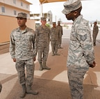 Airman 1st Class Jon Davila, Luke Honor Guard member, receives instruction on his stance in formation from Tech Sgt. Jerome Bryan, U.S. Air Force Honor Guard instructor, April 16, 2018, at Luke Air Force Base, Ariz. Air Force Honor Guard instructors will be at Luke teaching local Honor Guard members special formations and demonstrations until April 25, where the trainees will perform everything they've learned in a graduation ceremony. (U.S. Air Force photo by Senior Airman Ridge Shan)