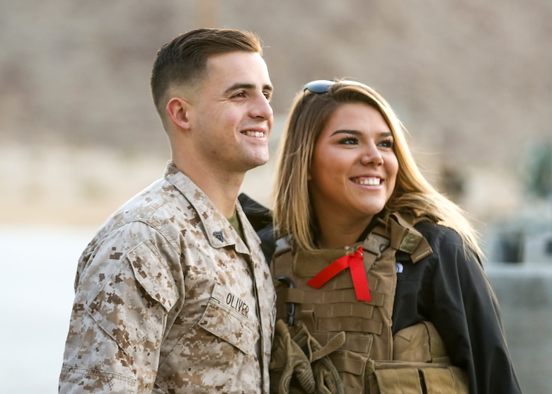 Sgt. John Oliver, vehicle commander, Alpha Company, 1st Tank Battalion, and his wife, Chelsea Oliver, participate in the unit's Jane Wayne Spouse Appreciation Day aboard the Marine Corps Air Ground Combat Center, Twentynine Palms, Calif., April 3, 2018. The purpose of the event is to build resiliency in spiritual well being, the will to fight and a strong home life for the 1st Tanks Marines and their families. (U.S. Marine Corps photo by Lance Cpl. Rachel K. Porter)