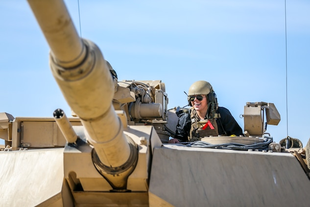 Chelsea Oliver, wife of Sgt. John Oliver, vehicle commander, Alpha Company, 1st Tank Battalion, participates in a ride-along in an M1A1 Abram's Tank during the unit's Jane Wayne Spouse Appreciation Day aboard the Marine Corps Air Ground Combat Center, Twentynine Palms, Calif., April 3, 2018.  The purpose of the event is to build resiliency in spiritual well being, the will to fight and a strong home life for the 1st Tanks Marines and their families. (U.S. Marine Corps photo by Lance Cpl. Rachel K. Porter)