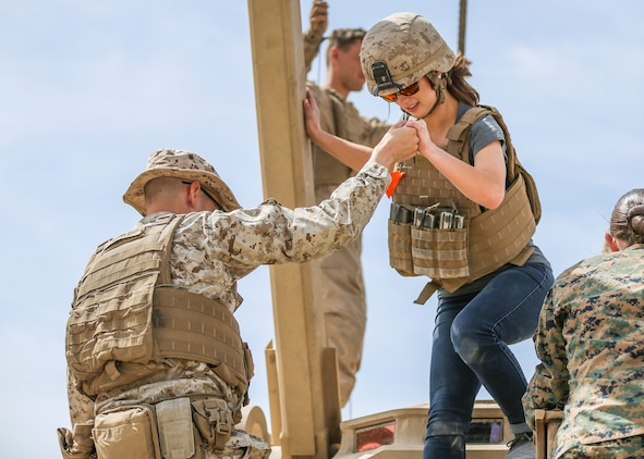 Sara Nepple, wife of Cpl. Caleb Nepple, gunner, Alpha Company, 1st Tank Battalion, takes part in the unit's Jane Wayne Spouse Appreciation Day aboard the Marine Corps Air Ground Combat Center, Twentynine Palms, Calif., April 3, 2018. The purpose of the event is to build resiliency in spiritual well being, the will to fight and a strong home life for the 1st Tanks Marines and their families. (U.S. Marine Corps photo by Lance Cpl. Rachel K. Porter)